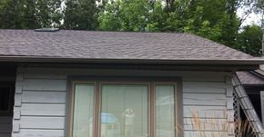 new gutters, roofing, and skylight